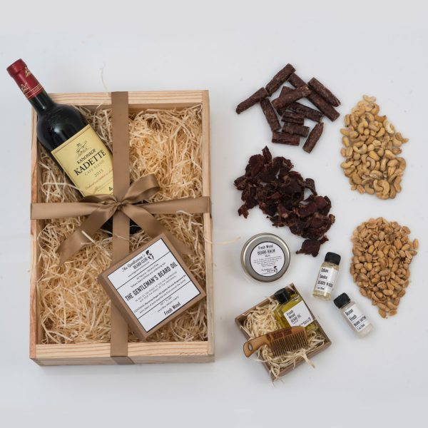 This Valentine's Day Gift For Him is packed with Beard Products, Nuts, Snacks, and Red Wine. All presented beautifully in a custom wooden apple crate.