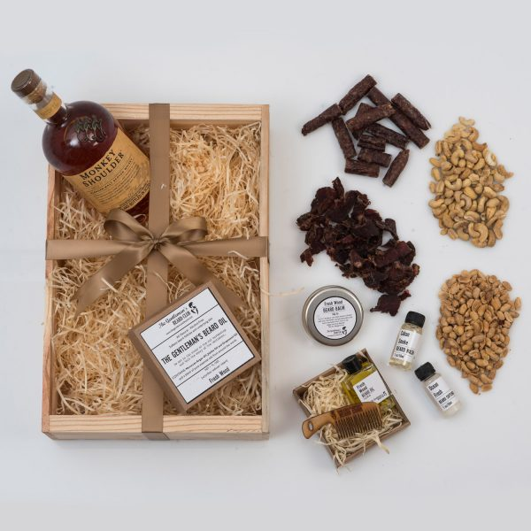 This Valentine's Day Gift For Him is packed with Beard Products, Snacks, and a Bottle of Whisky. All presented beautifully in a custom wooden apple crate.