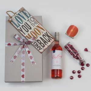 This Valentine's Day Romantic Gift includes a range of different love gifts, including a candle and metal sign, combined with a bottle of Rose.