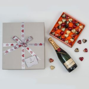 Valentine's Gift With Chocolates & Champagne from Hamper World. This Valentine's gift includes a large box of Chocoloza Chocolates, a bottle of Champagne and a bracelet. Delivered Nationwide In A Custom Gift Box.