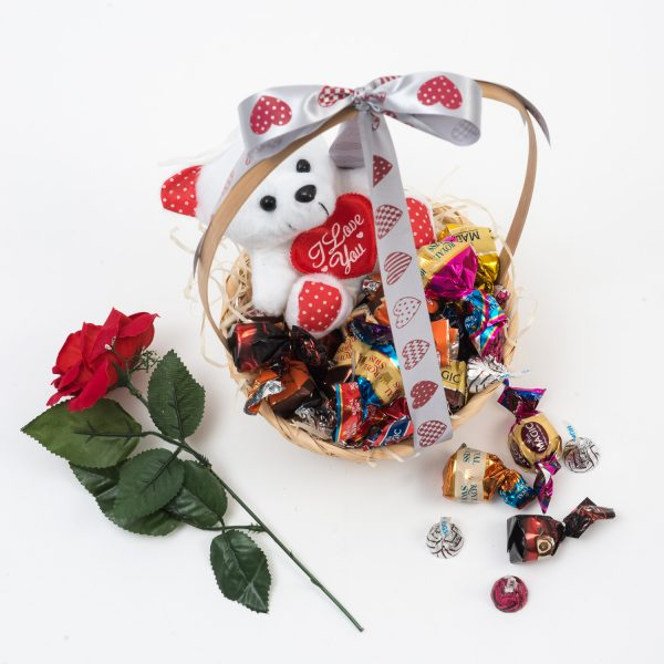 Valentine's Day Gift Basket - Chocolates & Teddy Bear from Hamper World. This Valentine's Day Gift Basket is filled with a range of different chocolates, a plush teddy bear and an artificial rose. Nationwide Delivery