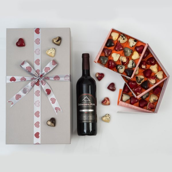 Valentine's Day Gift - Boutique Wine & Chocolates fr om Hamper World. This Valentine's gift includes a 3 tier box of Heart-Shaped Chocoloza Chocolates and a bottle of Boutique Red Wine in a custom Valentine's themed gift box.