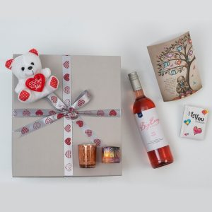 Valentine's Day - Romantic Gift Hamper from Hamper World. This Romantic Gift Hamper For Valentine's Day includes a range of gifts and a bottle of wine in a custom gift box. Delivered Nationwide.
