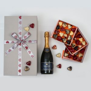 This Valentine's gift includes a 3 tier box of Exclusive Chocoloza Chocolates in the shape of hearts and a bottle of Bubbly in a custom made gift box.