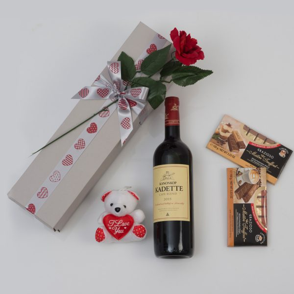 This Valentine's Day Hamper is made up of a Bottle of Red Wine and Chocolates packed and delivered in a custom made, love-themed gift box: