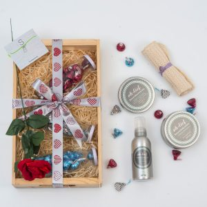 This Valentine's gift includes a range of Chocolates in glass jars and a selection of Oh Lief Bath & Body Products in a custom wooden tray