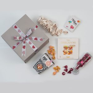 This Valentine's Day Love Gift is made up of a small book and a selection of sweets and chocolates. Packed and delivered in a custom love-themed gift box