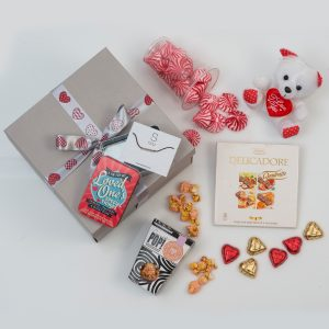 This Valentine's Day Hamper is made up of a range of romantic gifts and a selection of sweets and chocolates. Delivered in a custom love-themed gift box.