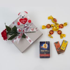 Valentine's Rose Sweets & Chocolates Gift Set includes a range of sweets and chocolates with a Valentine's rose and plush teddy bear in a custom, love themed gift box.