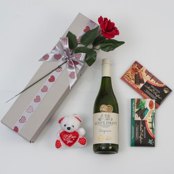 This Valentine's Day Hamper is made up of a Bottle of White Wine and Chocolates packed and delivered in a custom-made, love-themed gift box.