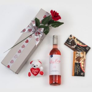 This Valentine's Day Gift is made up of a Bottle of Rose Wine and Chocolates packed and delivered nationwide in a custom made, love-themed gift box.