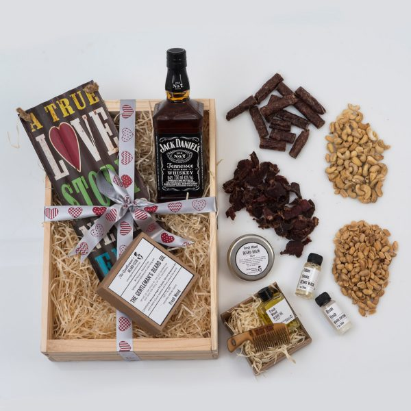 This Valentine's Day Gift For Men is packed with Beard Products, Nuts, Snacks and a Bottle of Whisky. Delivered in a custom wooden apple crate.