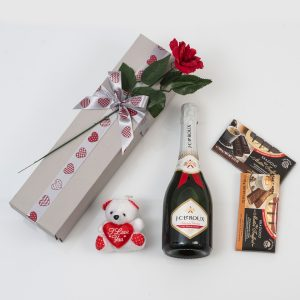 This Valentine's Day Gift is made up of a Bottle of Bubbly and Chocolates packed and delivered in a custom made, love-themed gift box.