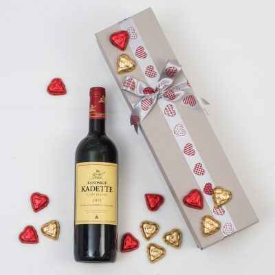 This Valentine's Day Wine Gift is made up of a Bottle of Red Wine with a range of Heart Shaped Chocolates in a custom gift box.