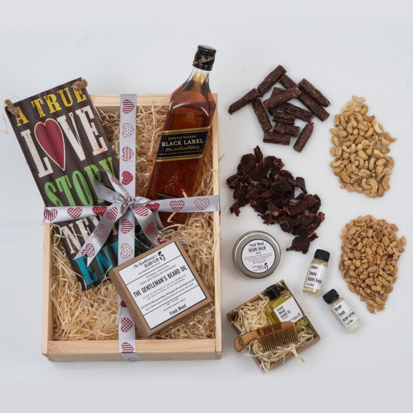 This Valentine's Day Gift For Him is packed with Beard Products, Nuts, Snacks, and a Bottle of Johnnie Walker in a custom wooden apple crate.