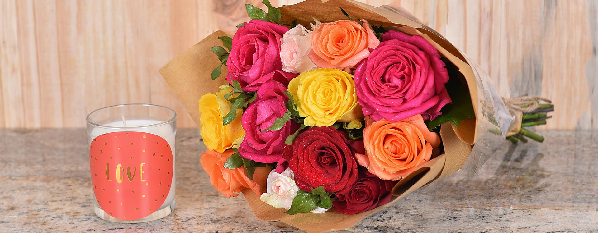 Order A Bouquet Of Roses With Candle | Hamper World